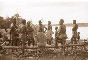 Discussing the lifestyle of saltwater crocodiles on the banks of the Strickland River. Papua New Guinea, December 1979