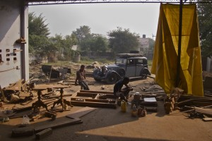 Crossing the hot plains of Gujerat to Rajasthan the wooden frame of the Rolls shrank, and on the rough roads of the Thar Desert nuts unscrewed from their bolts.  Parts fell off.   I spent a day here working with the carpenters to fix the damage.